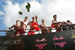 © licensed to London News Pictures. London, UK 12/05/2012. 100 Lifeguards throwing underwears from a double decker bus as they promote opening of the new Gilly Hicks and Hollister Flagship Stores on Regent Street, this morning (12/05/12). Photo credit: Tolga Akmen/LNP