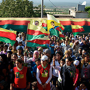 August 12, 2012 - Kafa Safra, Efrin, Syria: Around five thousand Syrian Kurdish attended the funeral and ceremony of martyrdom of Taliz Gadalum, a Kurdistan Workers' Party (PKK) fighter killed days earlier during combat against the Turkish army...PKK has been fighting an armed struggle against the Turkish state for an autonomous Kurdistan and greater cultural and political rights for the Kurds in Turkey, Iraq, Syria and Iran. Founded on 27 November 1978 in the village of Fis, was led by Abdullah Öcalan. The PKK's ideology was originally a fusion of revolutionary socialism and Kurdish nationalism - although since his imprisonment, Öcalan has abandoned orthodox Marxism. The PKK is listed as a terrorist organization by Turkey, the United States, the European Union and NATO. (Paulo Nunes dos Santos)