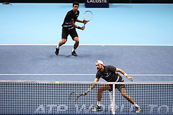 Lukasz Kubot and Marcelo Melo during the Doubles match during day six of the Nitto ATP Finals at The O2 Arena, London. PRESS ASSOCIATION Photo. Picture date: Friday November 16, 2018. See PA story TENNIS London. Photo credit should read: John Walton/PA Wire. RESTRICTIONS: Editorial use only, No commercial use without prior permission.