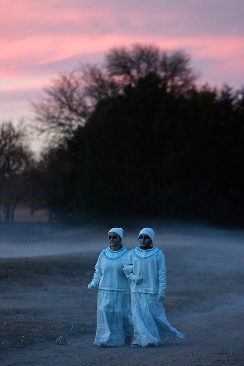 A pair of ghostly twins, Kimberly Ruiz and Valey Juarez, roam the grounds of the Stuhr Museum Friday during All Hallows Evening.