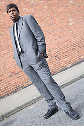 Young man wearing suit standing out in the street,