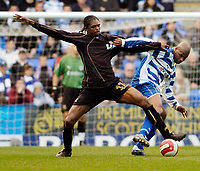 Photo: Leigh Quinnell.<br /> Reading v Portsmouth. The Barclays Premiership. 17/03/2007. Readings Michael Duberry battles with Portsmouths Nwankwo Kanu.