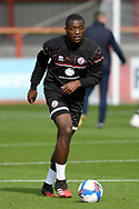 Crawley Town defender Manny Adebowale (17) warming up before the EFL Sky Bet League 2 match between Cheltenham Town and Crawley Town at Jonny Rocks Stadium, Cheltenham, England on 10 October 2020.