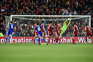 a free kick from Bosnia and Herzegovina's Miralem Pjanic (10) is saved by Wales goalkeeper Wayne Hennessey. Euro 2016 qualifying group B match, Wales v Bosnia- Herzegovina at the Cardiff city Stadium in Cardiff, South Wales on Friday 10th Oct 2014.<br /> pic by Andrew Orchard, Andrew Orchard sports photography.