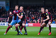 Lee Cattermole of Sunderland (6) wrestles with Kyle Wootton of Scunthorpe United (29) as Jimmy Dunne of Sunderland (30) looks on during the EFL Sky Bet League 1 match between Scunthorpe United and Sunderland at Glanford Park, Scunthorpe, England on 19 January 2019.
