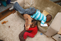 Children playing rough and tumble