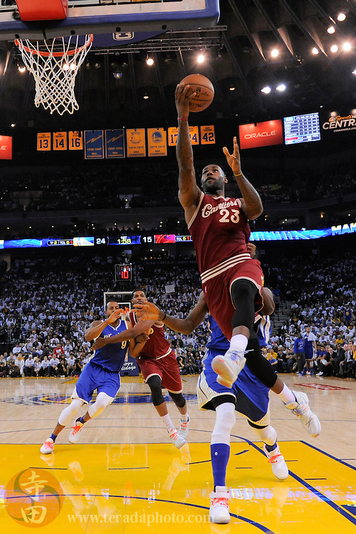 December 25, 2015; Oakland, CA, USA; Cleveland Cavaliers forward LeBron James (23) shoots a layup during the first quarter in a NBA basketball game on Christmas against the Golden State Warriors at Oracle Arena. The Warriors defeated the Cavaliers 89-83.