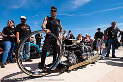 """Tarso Marques double hub-less motorcycle with 36"""" wheels, center-hub steering and a 550+ cubic inch Rolls Royce aircraft engine from Brazil at the annual Boardwalk Bike Show during Daytona Bike Week. FL. USA. Friday March 16, 2018. Photography ©2018 Michael Lichter."""