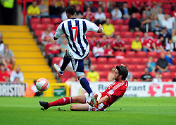 Bristol City's Cole Skuse slides in to take the ball ahead of West Bromwich Albion's Jerome Thomas  - Photo mandatory by-line: Joseph Meredith / JMPUK - 30/07/2011 - SPORT - FOOTBALL - Championship - Bristol City v West Bromwich Albion - Ashton Gate Stadium, Bristol, England