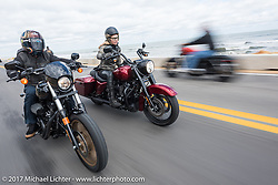 """Custom bike builder Jesse Rooke (L) on a new 2017 Harley-Davidson Milwaukee 8 rides alongside Iron Lilly Leticia Cline as she tests the all new 2017 Harley-Davidson Road King Special with its 107"""" Milwaukee-Eight engine north on A1A near Flagler Beach during Daytona Beach Bike Week. FL. USA. Tuesday, March 14, 2017. Photography ©2017 Michael Lichter."""