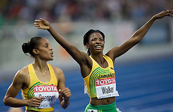 Kaliese Spencer of Jamaica  and Melaine Walker (R) of Jamaica celebrate when winning the gold medal in the women's 400 Metres Hurdles Final during day six of the 12th IAAF World Athletics Championships at the Olympic Stadium on August 20, 2009 in Berlin, Germany. (Photo by Vid Ponikvar / Sportida)