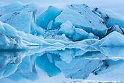 Blue icebergs reflected in the glacial lagoon at Jökulsárlón