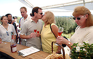 Dave Mackenzie and Jeanine Mackenzie kiss as Wendy Mackenzie, all from Pheonix, Arizona, samples a glass of Iron Horse Brut Rosé sprakling wine at Iron Horse Vineyard in Sebastopol, Calif. on Saturday Sept. 27, 2003. (Photo by Jakub Mosur)