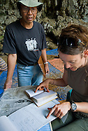Geologists Wasisto (Indonesia Center for Archaeology) and Kira Westaway review notes on 100,000 years of stratigraphy exposed with a 6-meter dig at Liang Bua Cave--thus far the longest record anywhere in Sountheast Asia.
