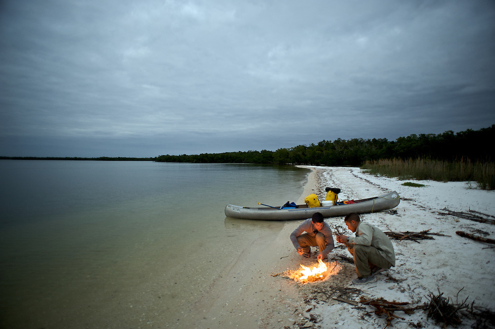 Brothers Brandon and Aaron build a fire on Gullivan Key in the Florida Everglades. The group stayed a few hours on Gullivan Key before embarking on a night paddle to Camp Lulu Key.