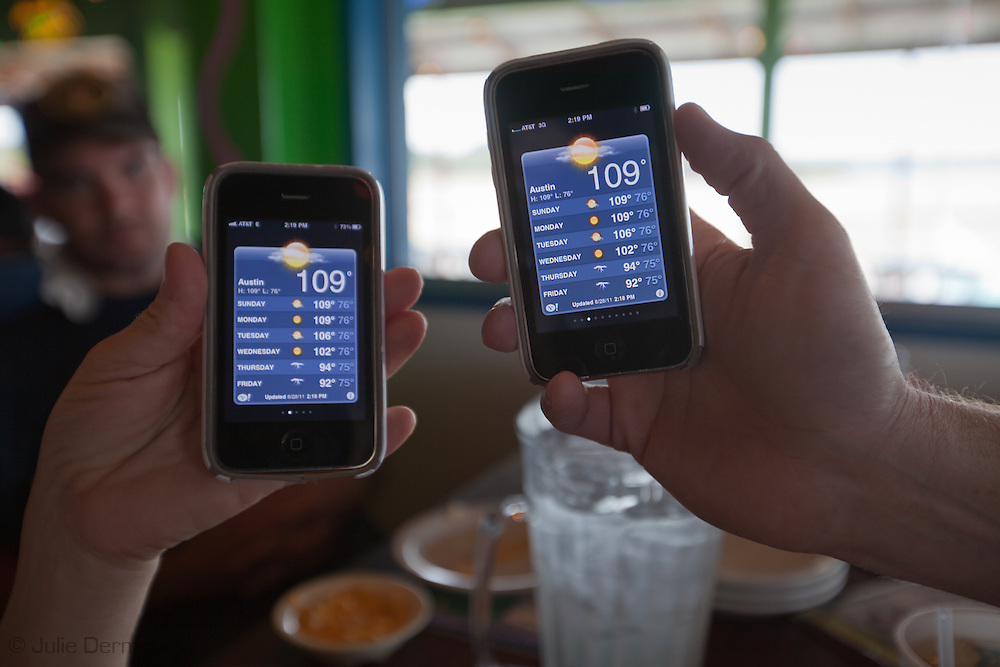 Customers at a restaurant on Lake Travis hold up their iphones showing temperatures at 109 Degrees in Austin Texas.The Drought in Texas will have long term environmental and finical impact.