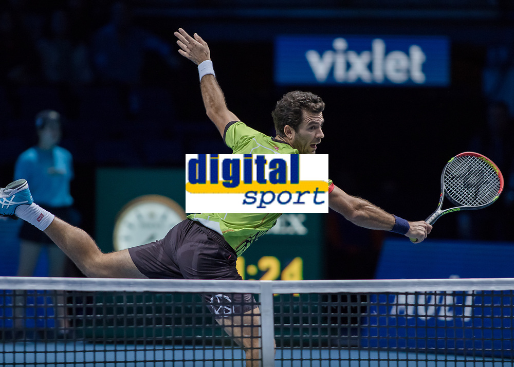 Tennis - 2017 Nitto ATP Finals at The O2 - Day One<br /> <br /> Mens Doubles: Group Eltingh/Haarhus: Jean Julien Rojer (Netherlands) & Horia Teacu (Romania) Vs Pierre-Hugues Herbert (France) & Nicolas Mahut (France)<br /> <br /> Jean-Julian Rojer (Netherlands) stretched out across the net at the O2 arena  <br /> <br /> COLORSPORT/DANIEL BEARHAM