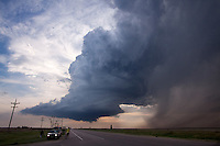 A supercell near Dodge City, Kansas, June 6, 2009.  Scientists working with Project Vortex 2 are in the foreground.