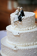 Photographer: Kevin Bartram.Radcliffe-Emmons 06-28-2008.The cake topper is returned to it's perch atop the cake after an accidental tumble from the top of the cake.