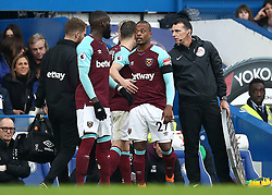 West Ham United substitute Patrice Evra (centre) enters the game