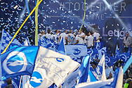 Brighton players on the stage celebrate during the Brighton & Hove Albion Football Club Promotion Parade at Brighton Seafront, Brighton, United Kingdom on 14 May 2017. Photo by Phil Duncan.