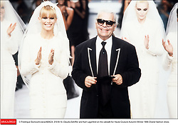 © Fredrique Dumoulin/Java/ABACA. 31518-10. Claudia Schiffer and Karl Lagerfeld on the catwalk for Haute Couture Autumn-Winter 1995 Chanel fashion show.