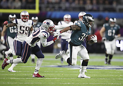 February 4, 2018 - Minneapolis, MN, USA - Philadelphia Eagles running back Corey Clement (30) tries to elude New England Patriots defensive back Duron Harmon LII Sunday, Feb. 4, 2018 in Minneapolis, Minn. (Credit Image: © Jerry Holt/TNS via ZUMA Wire)
