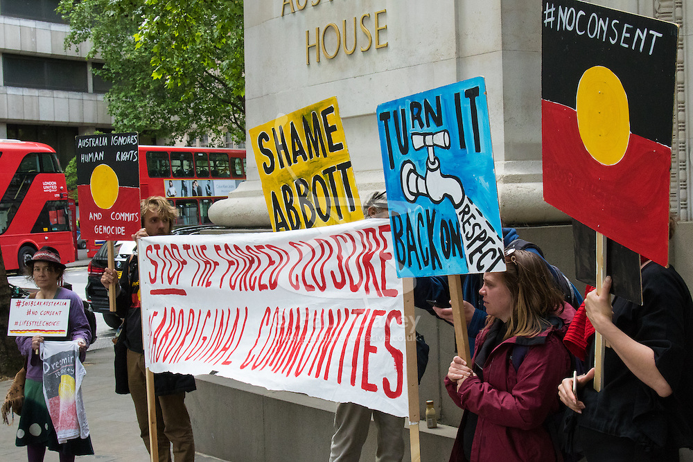 """Australian High Commission, London, June 1st 2015. Aboriginal rights protesters demonstrate outside the Australian High Commission in London against  the closure of up to 150 remote Aboriginal communities in Western Australia as the State Government under Premier Colin Barnett intends to close off municipal services by shutting off power and water. The protest also condemns the Prime Minister of Australia Tony Abbott who accuses Aboriginal peoples of """"making lifestyle choices""""."""