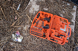 03 November, 2005.  New Orleans, Louisiana. Post Katrina. <br /> The remains of debris strewn Oak Grove trailer park in Saint Bernard parish just south of New Orleans. Hurricane Katrina caused a 20ft tidal surge to sweep over the land, devastating much of the parish. A tool kit lies in the litter deposited by the flood waters.<br /> Photo; ©Charlie Varley/varleypix.com