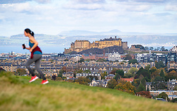 Edinburgh, Scotland, UK. 8 October 2020. Woman running on Blackford Hill  takes advantage of sunny dry weather in Edinburgh. Iain Masterton/Alamy Live News