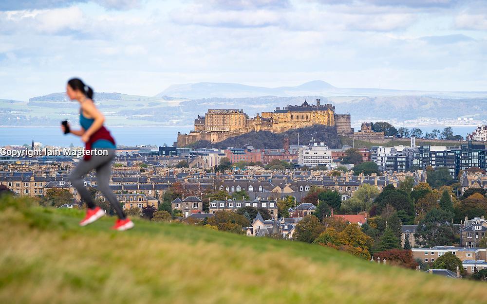 Edinburgh, Scotland, UK. 8 October 2020. Woman running on Blackford Hill  takes advantage of sunny dry weather in Edinburgh. Iain Masterton/Alamy Live News