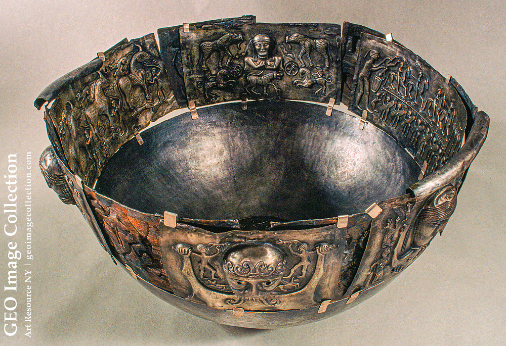 The silver cauldron of Gundestrup, one of the most widely studied Celtic relics , was discovered in a Danish peat bog in 1891.  The second-century B.C. object probably came to Denmark as war booty.  It is 27 inches wide.  The outside plat es feature a gallery of deity heads as well as natural and imaginary humans and animals and ritual scenes such as a drowning.  The bowl is from the La Tene period or late Iron Age (450 B.C.-100 A.D.)