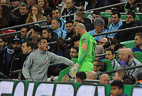 Football - 2019 EFL League Cup Final (Carabao Cup) - Manchester City vs. Chelsea<br /> <br /> Chelsea coach Gianfranco Zola holds back substitute keeper, Willy Caballero who was waiting to come on for, Kepa Arrizabalaga at Wembley Stadium.<br /> <br /> COLORSPORT/ANDREW COWIE