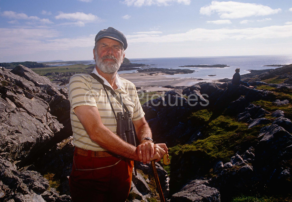 A portrait of Lord Strathcona on rocks of the Scottish island his family has owned for generations, in the summer of 1989 on Colonsay, Scotland. Donald Euan Palmer Howard, 4th Baron Strathcona and Mount Royal b1923, is a British Conservative politician. Strathcona is the eldest son of Donald Howard, 3rd Baron. He served in the Royal Navy from 1942 to 1947, achieving the rank of Lieutenant. Howard succeeded his father in the barony in 1959 and took his seat on the Conservative benches in the House of Lords.