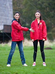 Chen Liu, Miss China and Chu Hay Man Hyman, Miss Hong Kong pose  during the caber tossing at the Miss World Highland Games..The Miss World 2011 contestants take part in a highland games in the grounds of Crieff Hydro, Perthshire..MISS WORLD 2011 VISITS SCOTLAND..Pic © Michael Schofield.