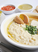 Hummus. A Levantine Arab dip or spread made from cooked, mashed chickpeas, blended with tahini, olive oil, lemon juice, salt and garlic. Served with hard boiled