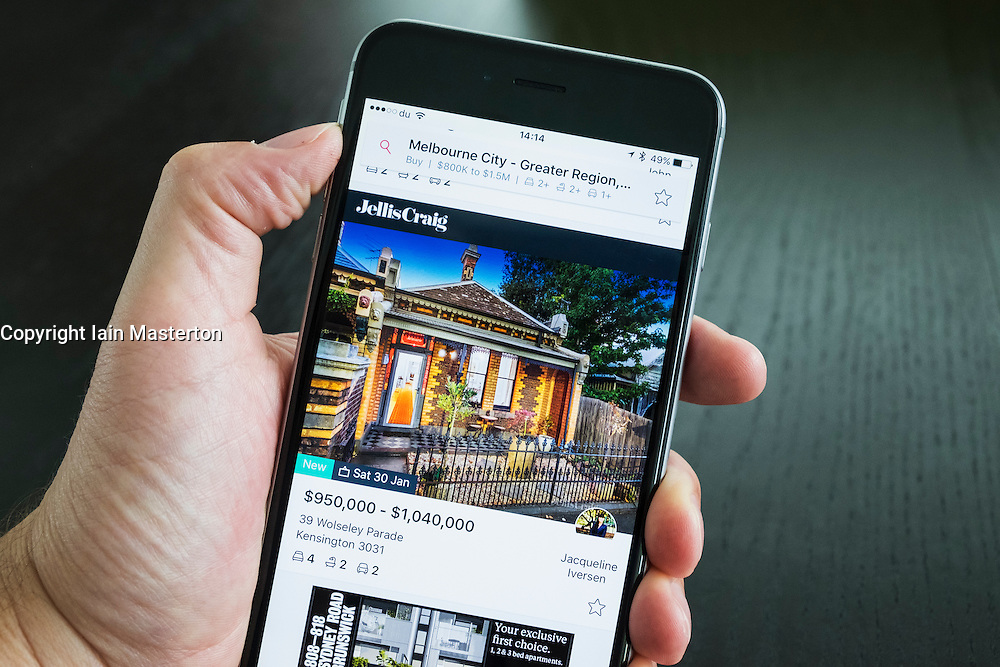 Australian house for sale on online real estate app on iPhone 6 plus smart phone