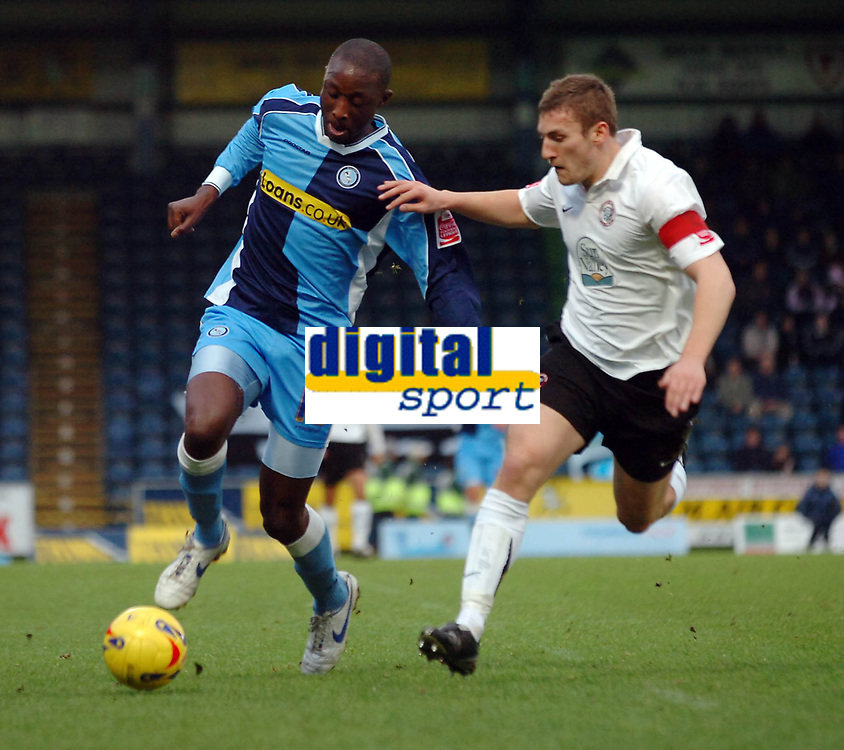 Photo: Kevin Poolman.<br />Wycombe Wanderers v Hereford United. Coca Cola League 2. 01/01/2007. Fola Onibuje of Wycombe and Phil Gulliver of Hereford go after the ball.