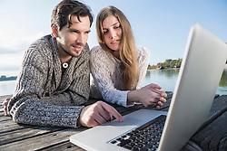 Couple working outdoors laptop computer