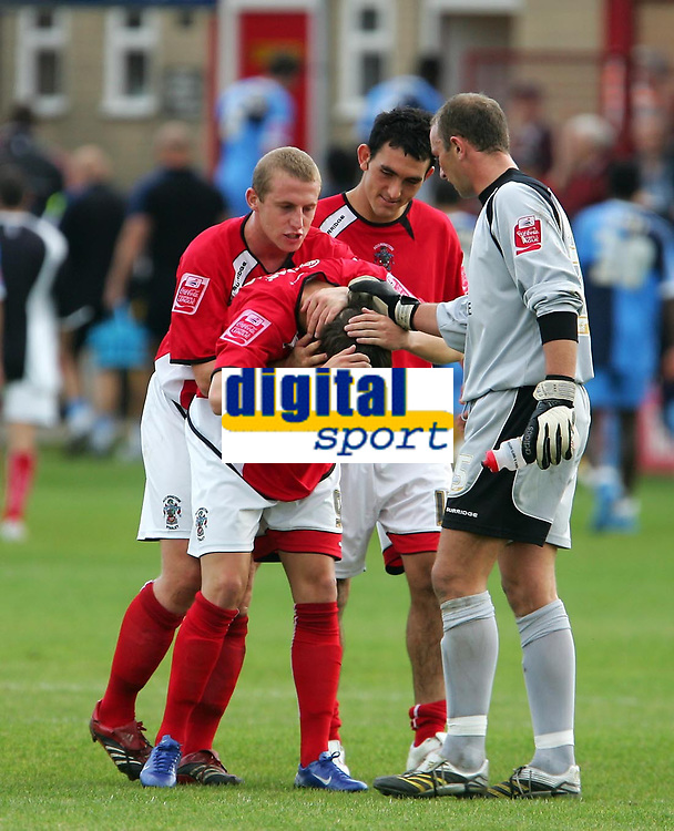 Photo: Andrew Unwin.<br />Accrington Stanley v Wycombe Wanderers. Coca Cola League 2. 30/09/2006.<br />Accrington Stanley's Andrew Mangan (C), the winning-goal scorer, is mobbed by his team-mates at the end of the game.