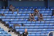 Alfredo Morelos (Rangers) sat in the stand amongst the substitutes during the Scottish Premiership match between Rangers and Livingston at Ibrox, Glasgow, Scotland on 25 October 2020.