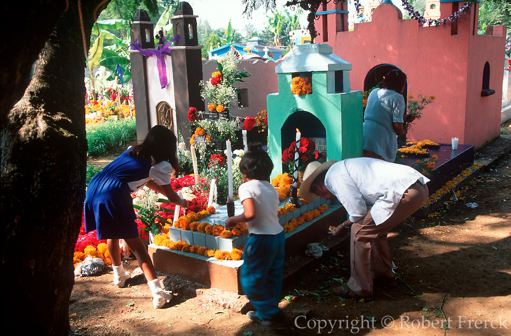 MEXICO, FESTIVALS Days of the Dead; family at grave