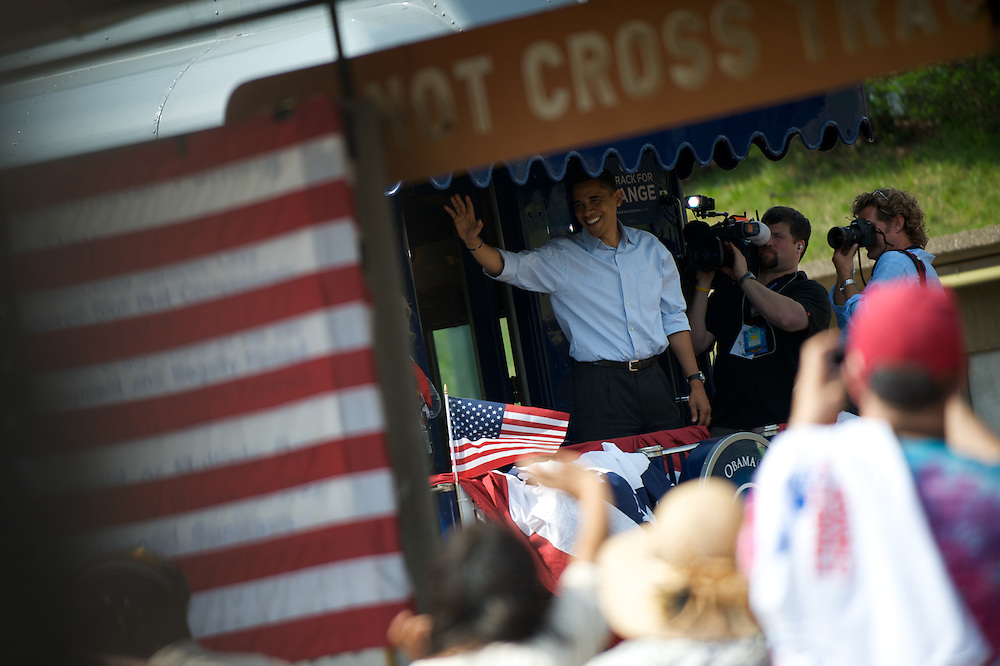 Waving to suporters, Senator Barack Obama campaigns by train in Pennsylvania.