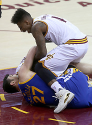 The Cleveland Cavaliers' Iman Shumpert, top, tussles with the Golden State Warriors' Zaza Pachulia in the third quarter during Game 4 of the NBA Finals at Quicken Loans Arena in Cleveland on Friday, June 9, 2017. The Cavs won, 137-116, trimming their series deficit to 3-1. (Photo by Phil Masturzo/Akron Beacon Journal/TNS) *** Please Use Credit from Credit Field ***