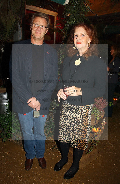 Actor ROBERT FOX and NERIDA PIGGIN at a party to celebrate the publication on 'A Year in My Kitchen' by Skye Gyngell held at The Petersham Nurseries, Petesham, Surrey on 19th October 2006.<br /><br />NON EXCLUSIVE - WORLD RIGHTS