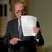 Minority Leader Charles Schumer (D-N.Y.) points at the partial transcript of President Trump and Ukrainian President Volodymyr Zelensky's phone call during a press conference on Wednesday, September 25, 2019.