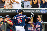 Minnesota Twins left fielder Josh Willingham is congratulated by his teammates after hitting his 2nd of 2 home runs against the Oakland Athletics on July 13, 2012 at Target Field in Minneapolis, Minnesota.  The Athletics defeated the Twins 6 to 3.  © 2012 Ben Krause