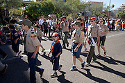 Boy scouts of Boy Scouts of America march in the Veterans Day Parade, which honors American military veterans, in Tucson, Arizona, USA.