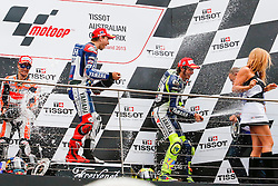 © Licensed to London News Pictures. 20/10/2012. Jorge Lorenzo (SPA), Dani Pedrosa (SPA) & Valentino Rossi (ITA) spray champagne on the podium  during the Race day of the round 16 2013 Tissot Australian Moto GP at the  Phillip Island Grand Prix Circuit Victoria, Australia. Photo credit : Asanka Brendon Ratnayake/LNP