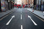 Arrows on a one way street point in the same direction on 21st January 2020 in London, England, United Kingdom. A one-way street is a street either facilitating only one-way traffic, or designed to direct vehicles to move in one direction. One-way streets typically result in higher traffic flow as drivers may avoid encountering oncoming traffic.